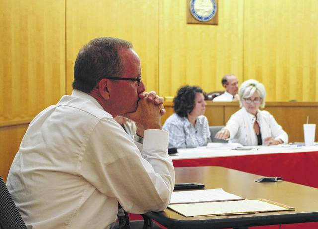 Hillsboro City Auditor Gary Lewis, foreground, is shown following a heated discussion with council members Tracy Aranyos, center, and Ann Morris, right. Council member Dick Donley is visible in the background, filling in for president Lee Koogler, who was absent.
