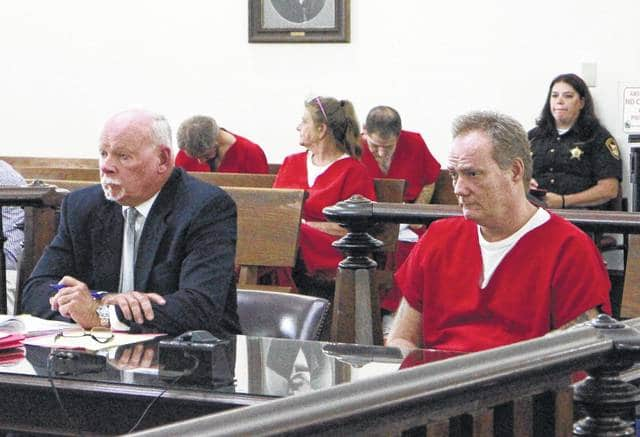 Richard Hillard, right, sits in Highland County Common Pleas Court Wednesday with defense attorney Bill Armintrout.