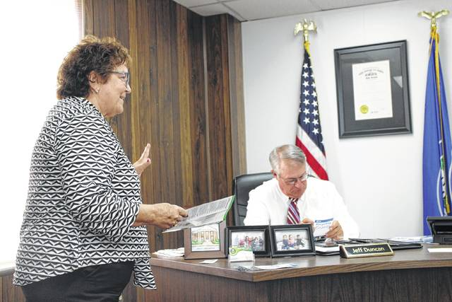 Joy Padgett, left, speaks to the Highland County Board of Commissioners Wednesday morning regarding a number of free services offered by the Ohio Environmental Protection Agency. Also shown is commissioner Jeff Duncan, right.