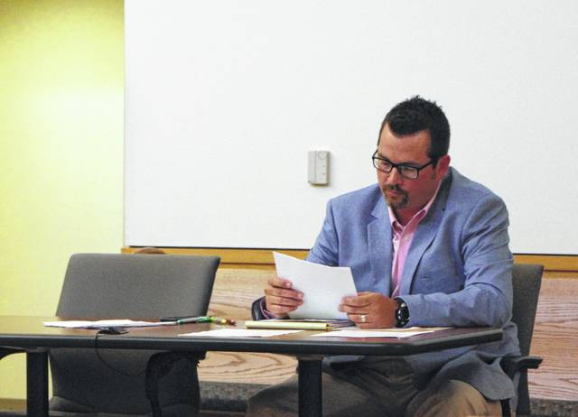 Hillsboro Safety and Service Director Mel McKenzie reviews notes during a Monday meeting of Hillsboro City Council.