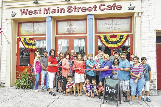 Shown are participants in a recent ribbon cutting ceremony for Momma's West Main Street Cafe in Hillsboro.