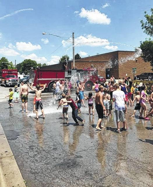 """Local kids gather in Greenfield recently for some fun in the sun at a """"water day"""" courtesy of Paint Creek Joint EMS/Fire District. The district recently announced it will hold a water day in the parking lot of the North East Street Fire Station in Hillsboro on Monday, July 31 at 1 p.m. A post on the district's Facebook page said the community's response to Greenfield's water days in previous years was """"so overwhelming,"""" district officials decided to host the event in Hillsboro as well. The water day will begin immediately following the Hillsboro City Schools' summer lunch stop in the fire station parking lot. Paint Creek public information officer Branden Jackman said the district hopes to host one more water day in Hillsboro before school starts."""