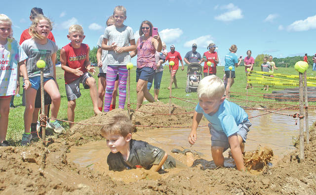Five-year-olds Ezra Rand and Kyson Greer compete in one of several youth races Saturday during the Amazing Race of Highland County.