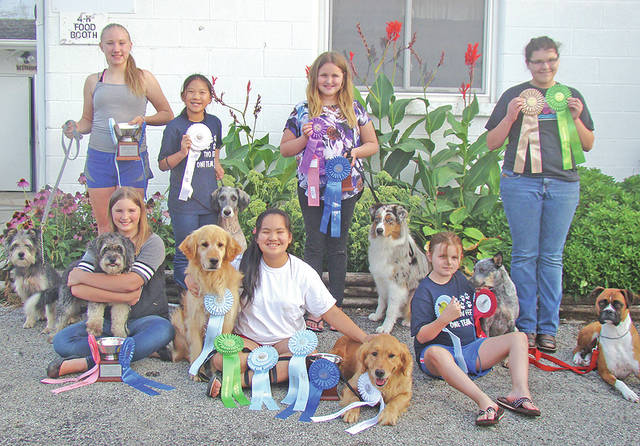 The Highland County Canine Commanders 4-H Club members that participated at the 2017 Ohio State Fair are pictured: (front row) Katherine Ogden, Kyah Chaney and Kiera Scott; (second row) Anne Marie Ogden, Emma Sanderson, Haiden Scott and MacKenzie Smith. Not pictured is Emmy Hawkins.