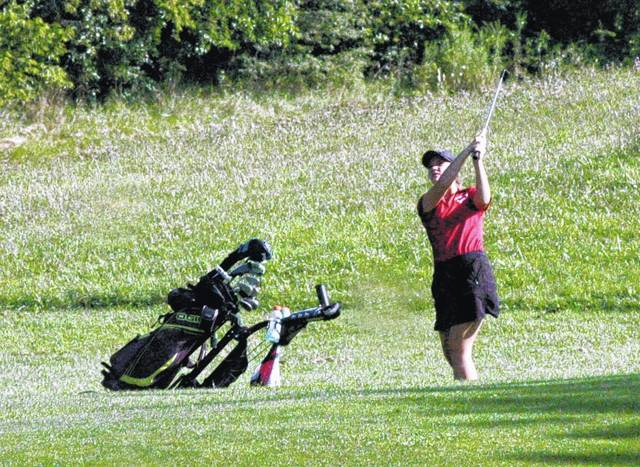 A member of the Fairfield Lady Lions golf team hits an approach shot on the eighteenth hole at Buckeye Hills Country Club during the McClain Invitational.