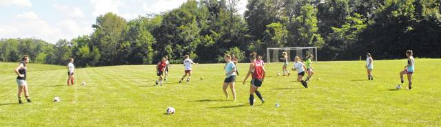 Members of the Fairfield Lady Lions soccer team perform a drill during practice.