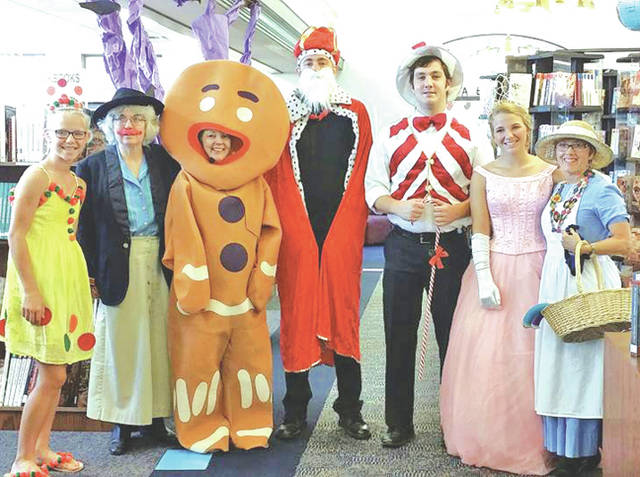 The is is pictured of the Greenfield Branch Library Summer Reading Fun cast of Candyland. Pictured, from left, are Kerrigan Pollard, Jennifer West, Sharon Aukeman, Drew Hamilton, Spencer McNeil, Kendall Pollard and Tonia McLanahan.