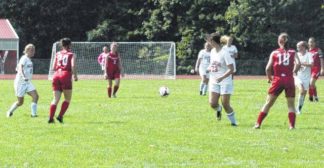 Members of the Lady Indians soccer team work to move the ball downfield on Saturday August 19 against the Eastern Lady Warriors.