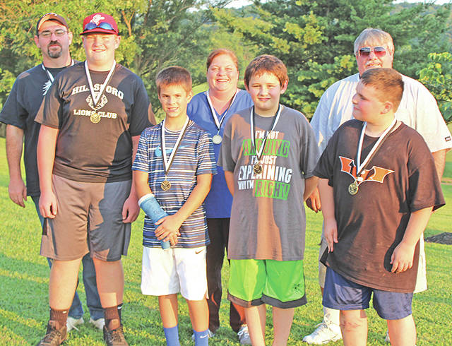 The Hillsboro Lions Club held its annual family picnic and honored the Lions Club Little League baseball team. Pictured are (front row, l-r) Jacob Allen, Casey West, Kaleb Mosher and Scott Fulkerson; (back row, l-r) coach Scott Fulkerson, scorekeeper Becky Fulkerson and coach Ron Fulkerson. Not pictured due to open house at the Hillsboro City Schools are players Landon Wolfe, Ashton Moyer, CJ Kemper, Griffin Puckett, Kenneth Hopkins, Noland Stroud, Brandon Manbeavers and David Conley.