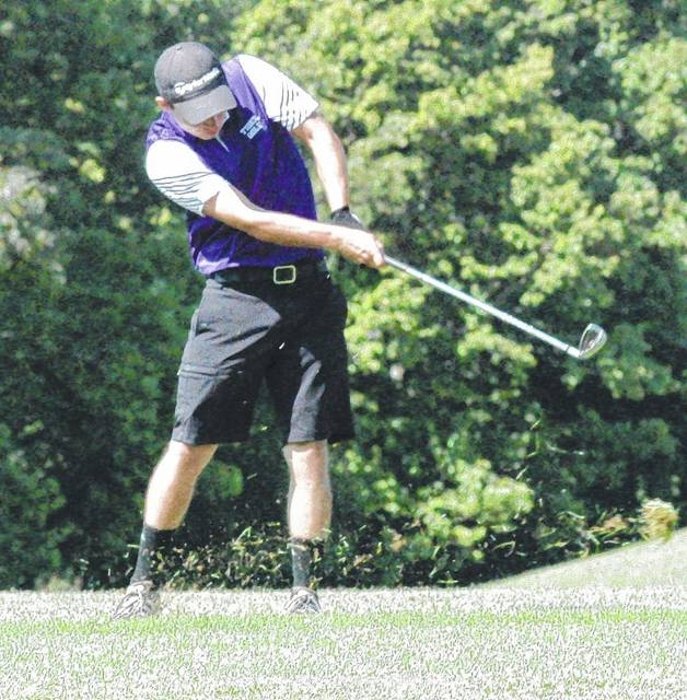 Trevor Newkirk takes his approach shot on hole number nine at Buckeye Hills Country Club on August 8 while participating in the Adam Sharp Memorial Tournament.