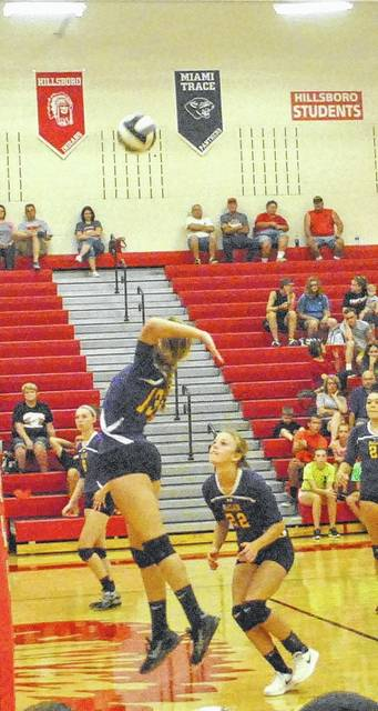 The McClain Lady Tigers try to secure a point against the Whiteoak Lady Wildcats on August 19 at Hillsboro High School during the Spike and Dig Tournament.