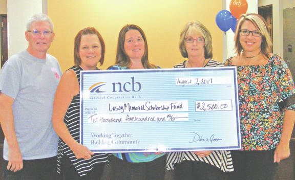 NCB recently donated $2,500 to the Hannah Losey Memorial Scholarship Fund. The Losey family lost their daughter, Hannah, in 2007, and created a scholarship fund in her memory. They have awarded over 75 scholarships totaling $57,500 to McClain High School students. Pictured, from left, are Hannah's parents, John and Brenda Losey, Allison Knisley, NCB customer service representative Cathy Collins, and NCB Assistant Branch Manager Jocelyn Leeth.