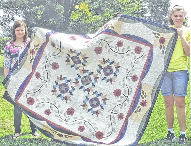 Pictured are Lillian Barry, left, and Sophia Barry, the daughters of Ed Barry of Winchester, who was the winner of the 2017 quilt raffle at the annual Quilts of Highland County.