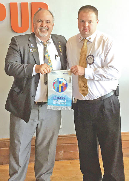 """Rotary District 6670 Governor Mark Mabelitini, left, visited the Greenfield Rotary Club on Aug. 3 and presented President Andrew Surritt with a Rotary flag commemorating the theme """"Rotary: Making a Difference."""" The district governor reported on activities within the district and in Rotary International, including efforts to eradicate polio from the face of the earth. Last year, only eight cases were reported worldwide. DG Mabelitini is a member of the Rotary Club of Sidney. Daren Donohoo (not pictured) also attended as the assistant governor for Area 12, which includes Greenfield, Hillsboro and Williamsburg."""