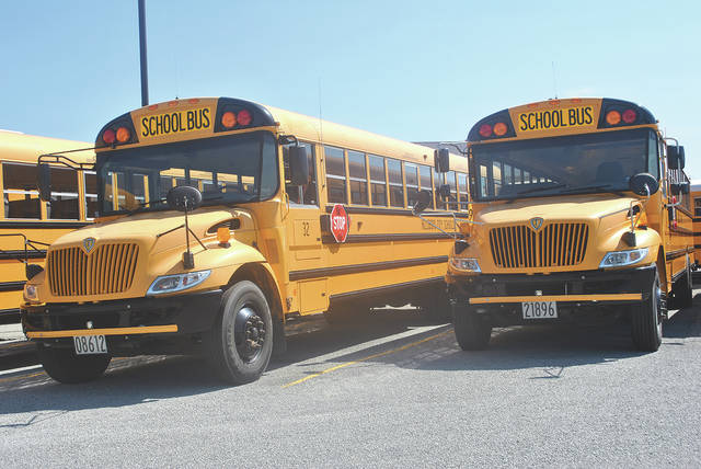 Hillsboro City School District buses were lined up at the bus facility Wednesday afternoon waiting to transport students for the first time this year next Tuesday.