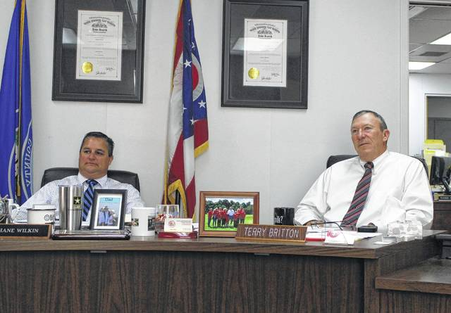 Highland County Board of Commissioners President Shane Wilkin, left, sits in a Wednesday commissioners meeting with commissioner Terry Britton.