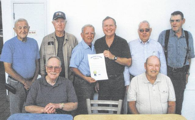 Past Highland Amateur Radio Association presidents are shown with a proclamation from the Ohio State Senate. Shown standing, from left, are Bob McFarland, Ron Bogard, John Levo, Dave Tourtelot, Lee Bishop and Harley Maines. Seated, from left, are Ted Ruble and Floyd Colville.