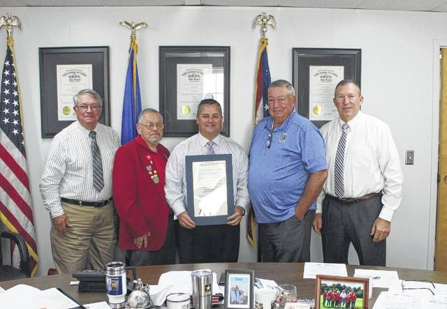 From left, Highland County Commissioner Jeff Duncan, David Grover, board of commissioners president Shane Wilkin, Charles Newland and commissioner Terry Britton pause for a photo at Wednesday's commissioners meeting. The commissioners declared Aug. 23 the Liberty Lions Club charter day. The Liberty Lions Club was recently formed, and currently has 24 charter members.