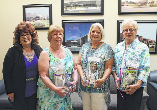 "Shown from left are Times-Gazette Media Sales Director Sharon Hughes and 2017 Highland County Women's Hall of Fame inductees Margaret ""Peggy"" Addington, Karen Faust and Janet Butler. The inductees are shown holding gifts sponsored by The Times-Gazette."