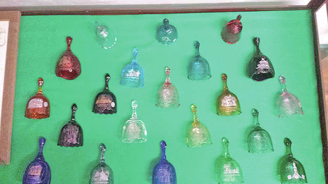 A complete set of Fenton Art Glass bells that were sold as fundraiser for the Festival of the Bells from 1991 to 2011 are pictured.