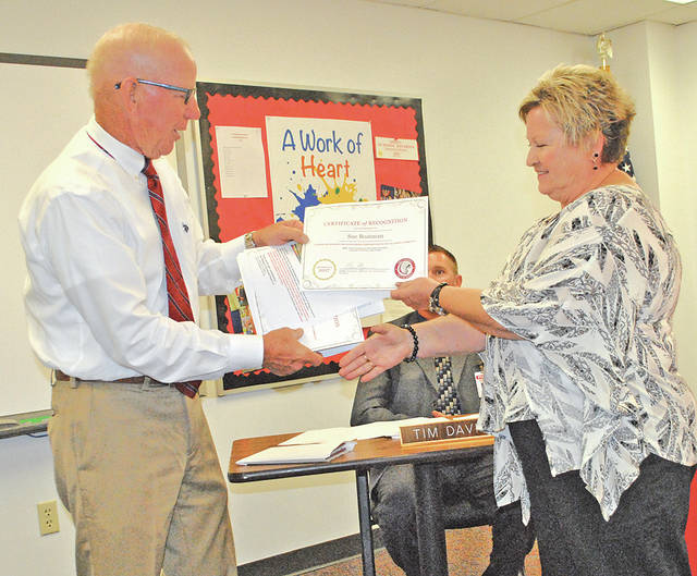 Sue Boatman, right, receives an OSBA Proud Products of Ohio Public Schools Award from Hillsboro Board of Education member Larry Lyons.