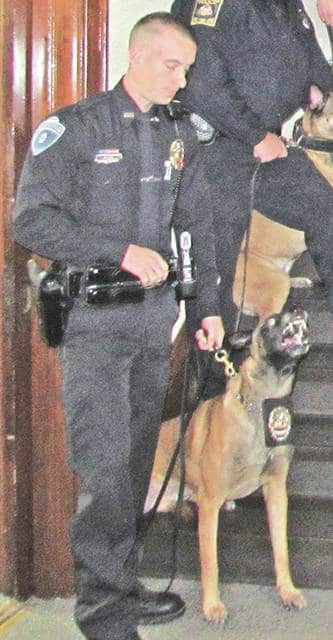 The Greenfield Police Department's K-9 Chica is shown with GPD patrolman Shawn Shanks.