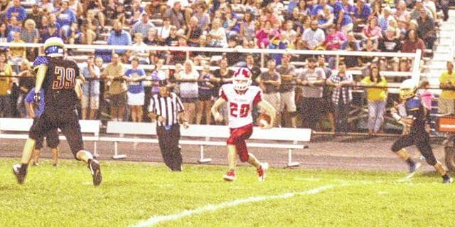 Britton Haines returns an interception late in the second quarter against CNE on Friday night at Clermont Northeastern High School.