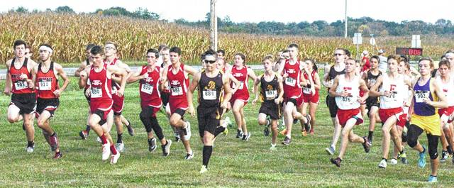 Athletes from the boys and girls cross country teams representing the five Highland County schools leave the starting line on Tuesday during the Highland County Invitational hosted by the Fairfield Lions.
