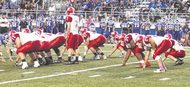 The Indians offense prepares for the snap against the Cavaliers defense on Friday night in Chillicothe.