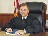 Highland County Common Pleas Judge Rocky Coss has been selected to preside over a lawsuit brought against the Fayette County Park District by a caterer.
