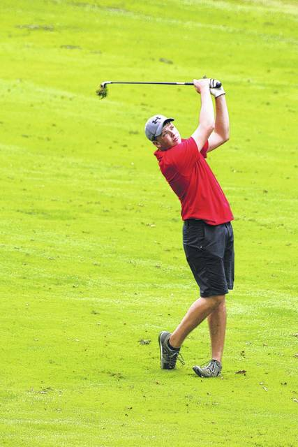 Will Keifer takes an approach shot from the fairway on Saturday at the inaugural FAC boys golf tournament in Chillicothe. Keifer also earned first-team All-FAC along with Trevor Newkirk and Kobe Penwell of McClain.