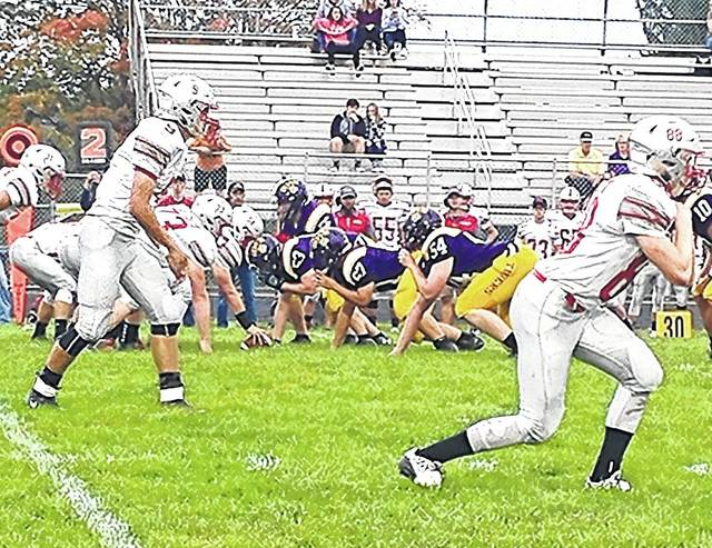 The McClain Tigers offense prepares to snap the ball in the first half on Friday at McClain High School against the East Clinton Astros.