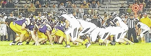 The Tigers offense readies for the snap on Friday at home against the visiting Panthers of Miami Trace.