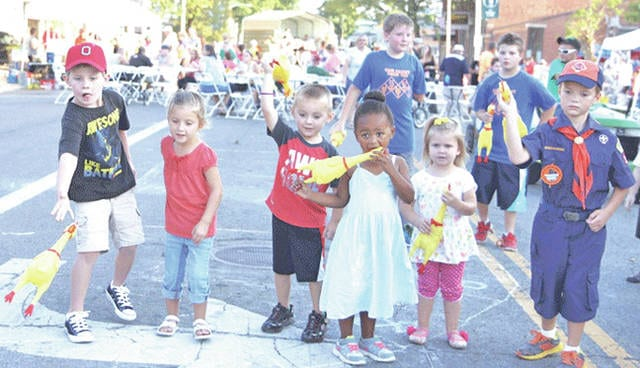 Kids participate in a chicken toss contest during last year's G3 Oktoberfest in downtown Greenfield.