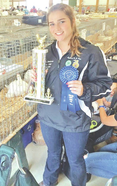 Kristin Jamieson is pictured with some of the awards she won at the fair.