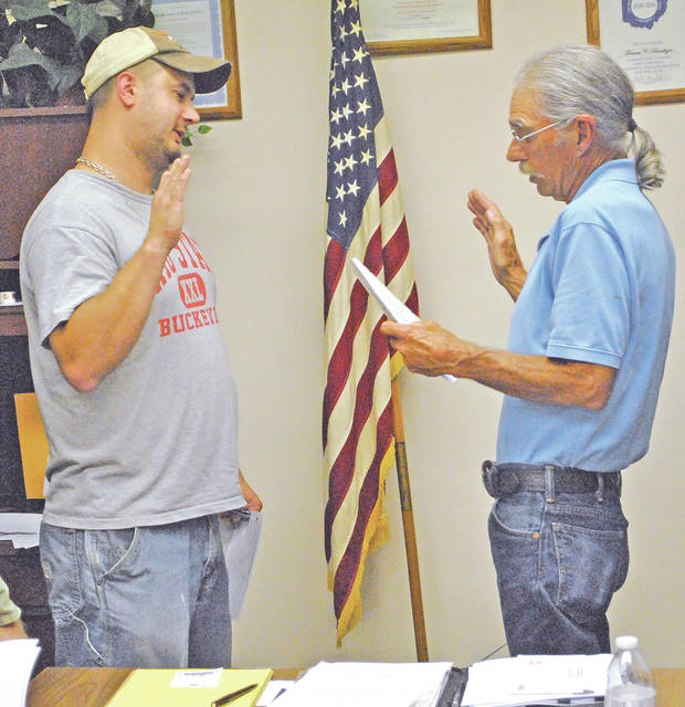 Mowrystown Mayor Frank Terwilliger, right, swears Jason Diekmeyer in as the newest member of Mowrystown Village Council during a regular council meeting last week.
