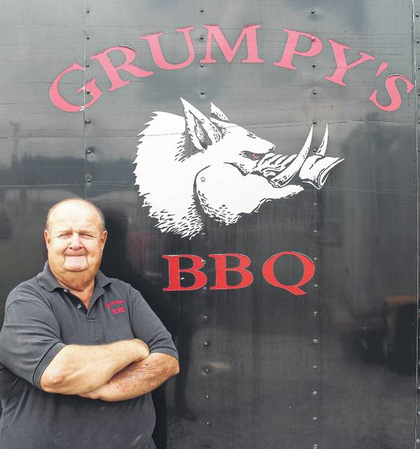 "Michael ""Grumpy"" Wagner stands next to his barbecue trailer on Tuesday at the Highland County Fair."