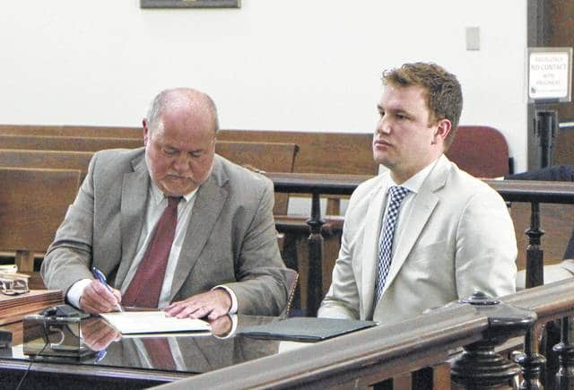 Seth Parshall, right, sits in court Wednesday with defense attorney Bruce Wallace. Parshall is charged with three counts of pandering obscenity involving a minor and eight counts of illegal use of a minor in nudity-oriented material or performance.