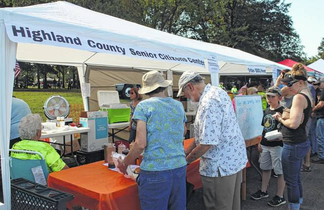 Volunteers with the Highland County Senior Center sell barbecue to hungry crowds Saturday at Smokin' in the Hills.