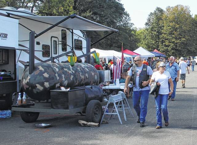 Nearly 1,000 people showed up over the weekend to Smokin' in the Hills, the inaugural barbecue cookoff set to be a yearly event at Rocky Fork Lake. The competition featured a variety of unique smokers and military tributes.