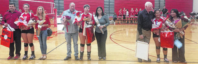 Senior members of the Hillsboro Lady Indians volleyball team Maddy Miller, Corrine Ray and Beth Taylor pose with their parents after being honored as part of the Lady Indians' senior night celebrations on Thursday.
