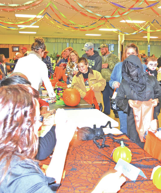 Trick or treaters and others passing out candy are pictured at a past Halloween Party at the Highland County Senior Citizens Center in Hillsboro.