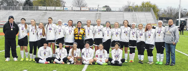 The Lynchburg-Clay High School Lady Mustangs pose for a picture Saturday at Waverly High School after winning their district final soccer match. Back row (l-r):Head Coach Dennis West, Chelsea Hart, Riley Creditt, Hailee Waits, Logan Binkley, Kali Cochran, Savannah Cochran, Serena Smith, Peyton Scott, Sierra Benney, Audrey Merry, Belle Brinkman, Kaylee Lunsford, Paige Flowers, Olivia Balon, Mikaela Tipton, Sam Kirby and Assistant Coach Chris Tipton. Back row (l-r): Jillian Bitzer, Taiyler Marcelino, Haylee Lay, Angela McLaughlin, Emily Pinkerton and Cailee Elam.