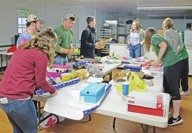 Members of the Highland County Junior Leadership Club recently packed and donated boxes for Operation Christmas Child. This is one of the community service projects the club is involved in throughout the year.