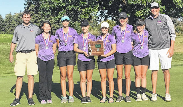 The Lady Tigers golf team poses with divisional runnerup trophy. From left to right : Assistant Coach Drew Hamilton, Cassidy Willis, Erika Martin, Elissa Grate, Kendall Pollard, Bryn Karnes, Bri Weller, Coach Jarrod Haines