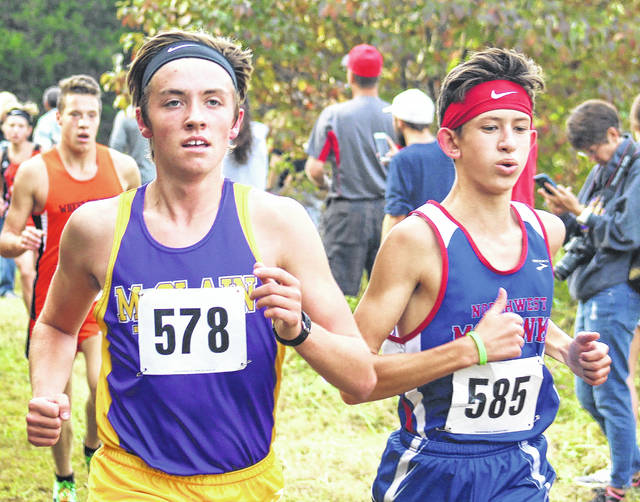 Reece Schluep, a junior at McClain High School, runs during the D II Southeast district Cross Country meet held on Saturday the University of Rio Grande.