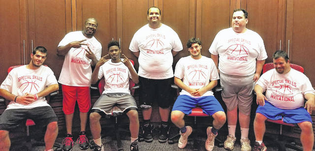 Highland County Special Olympics team members pose in the OSU basketball locker room on Sept. 28 during their tour of the facilities at the 2017 Special Skills Basketball Invitational held at Value City Arena. Pictured (l-r): Josh Rollins; Terrell Willis; Malik Rutledge; DJ Green; Jordan Humphrey; Chris Tissot; Travis Emery.