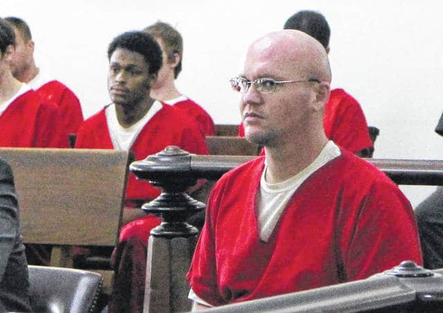 Gerald Denise glances at the camera on Thursday during a hearing in Highland County Common Pleas Court. Denise was sentenced to four years in prison after he pled guilty to drug and firearm charges.