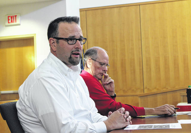 Nate Green, a consultant with the Montrose Group of Columbus, speaks to citizens at a public hearing at the Highland County Justice Center on Friday evening. Also shown is Hillsboro City Council member Dick Donley.