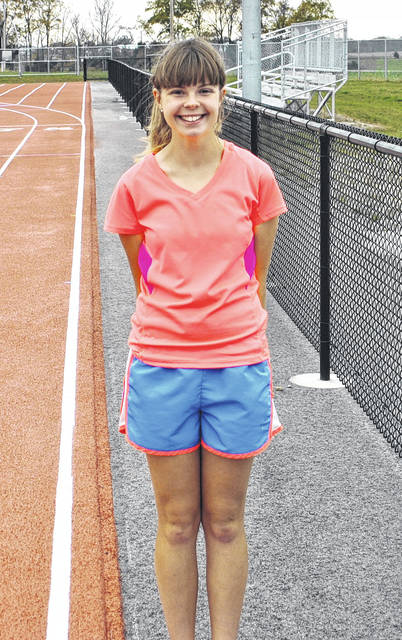 Ciara Colwell poses for a photo on Thursday at the Fairfield High School track. Colwell, the first female state cross country qualifier in Fairfield history, will compete at the State meet on Saturday.